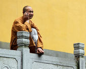 Buddhist monk with mobile phone — Stock Photo