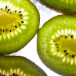 Ripe sliced fresh kiwi fruit - Stock Photo