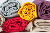 Colourful rolled cotton towels — Stock Photo