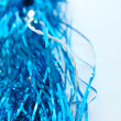 Royalty-Free Stock Photo: Blue tinsel and Christmas lights