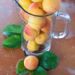 Ripe fresh apricots in jar — Stock Photo #11617418