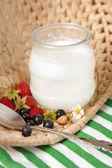 Creamy yoghurt in glass jar — Stock Photo