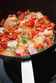 Chicken pan fry with red peppers — Stock Photo