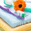 Photo: Toothbrush with toothpaste on fresh towels