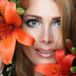 Woman and flowers — Stock Photo