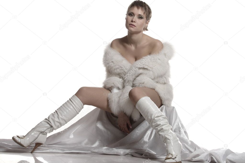 Sexy girl with white fur coat on a white background — Stock Photo #11777072