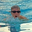 Stock Photo: A Preteen Boy Swimming