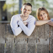 Couple by fence — Stock Photo #11185658