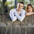 Couple by fence — Stock Photo #11312133