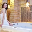 图库照片: Girl in hot tub