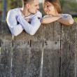 Couple by the fence — Stock Photo