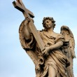 Statue at San&amp;#039;t Angelo Bridge in Rome - Stock Photo