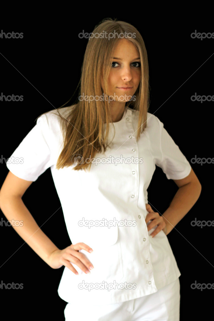 Pretty young female doctor posing in uniform — Stock Photo #12148896