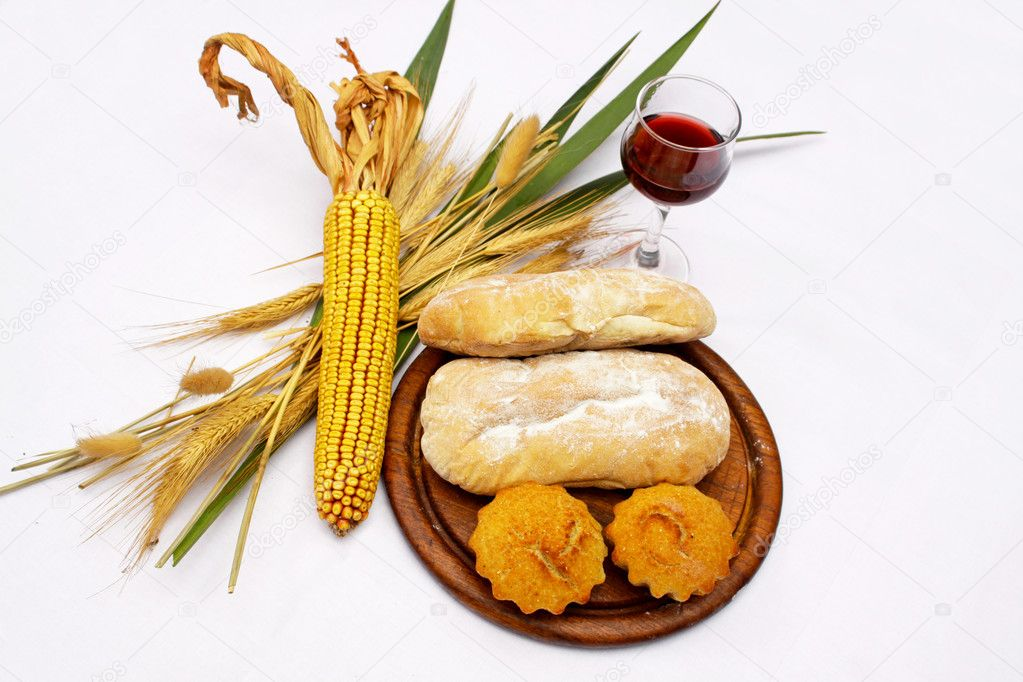 Variety of bread decorated with corn and wheat and vine  Stock Photo #12148991
