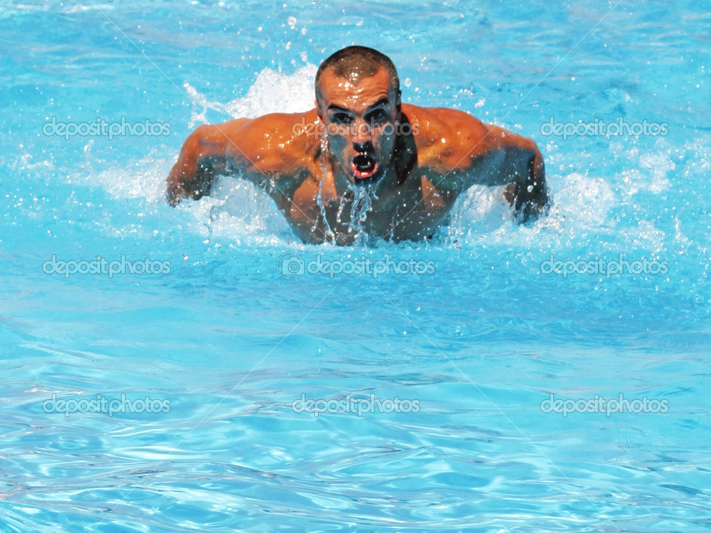 Athlete swimmer training hard in a swimming pool  Stock Photo #12161733