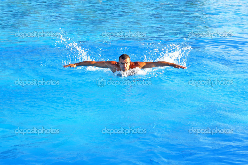 Hard swim training in a swimming pool — Stock Photo #12162359