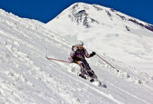 Woman skier in the deep snow — Stock Photo
