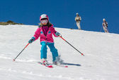 Girl on skis in the mountains — Stock Photo