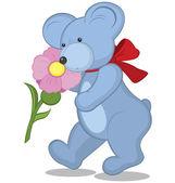 Blue Teddy bear with flower — Stock Vector