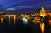 Guadalquivir River and the Torre del Oro, in Seville, Spain at n — Stock Photo