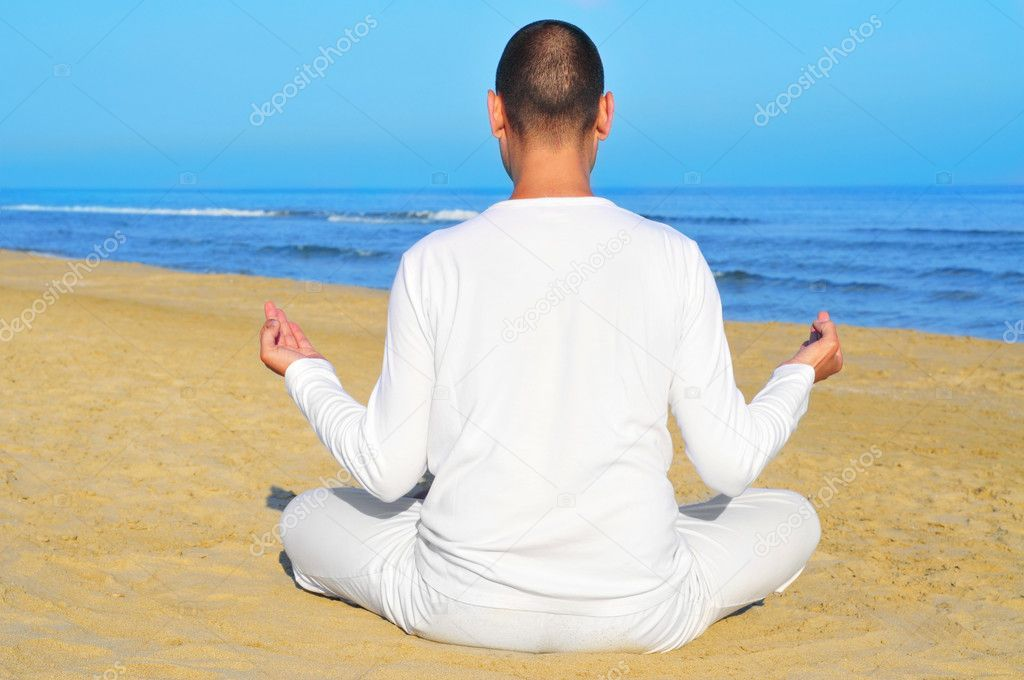 Someone meditating on the beach — Stok fotoğraf #10916826