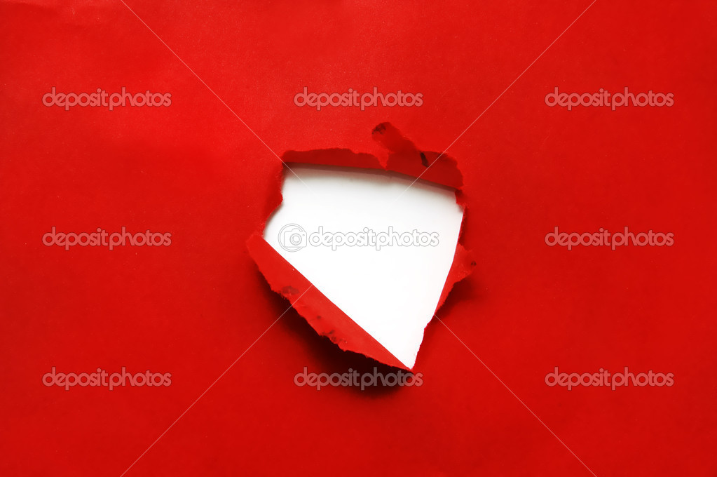One hole on a  red paper background — Stock Photo #10923515