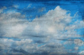 Clouds on a textured paper background — Stock Photo