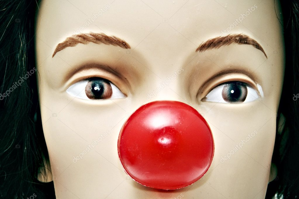 Clown nose on the face of a woman  Stock Photo #12020508