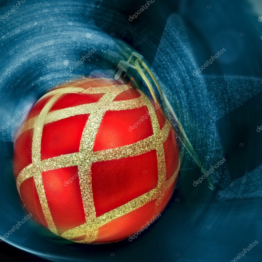 Red and golden christmas ball on an abstract background with a star — Stock fotografie #12085201