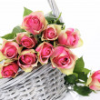 Pink roses in basket — Stock Photo