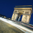 Arc de Triomphe by night with car lights — Stock Photo #11641019