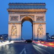 Arc de Triomphe by night - Stock Photo