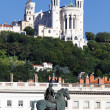 Statue of Louis XIV and Basilique Fourviere — Stock Photo #11962797
