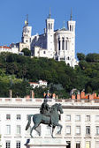 Statue of Louis XIV and Basilique Fourviere — Stock Photo