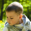Close up portrait of a beautiful kid outdoor - Stock Photo