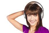 Pretty woman listening, and enjoying music — Fotografia Stock