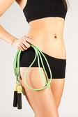Nice sporty women body. Holding rope — Stock Photo