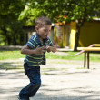 Happy kid playing in street — Stock Photo #11090338