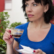 Happy woman drinking coffee - Stock Photo
