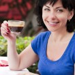 Happy woman drinking coffee — Stock Photo