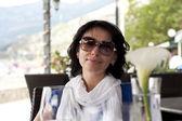 Beautiful woman in street cafe — Stock Photo