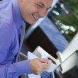Businessman working outdoor, with laptop — Stock Photo #11356702