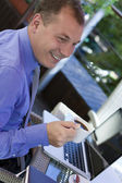 Businessman working outdoor, with laptop — Stock Photo
