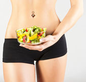 Happy healthy woman with salad. Studio shoot — Stock Photo
