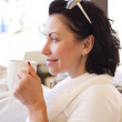 Young attractive woman, sitting in a cafe with a coffe — Stock Photo