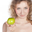 Smiling attractive woman offers a green apple, isolated — Stock Photo #11937467