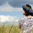 Woman on the field. View from the back. Summertime — Stock Photo