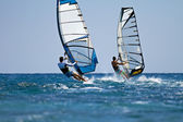 Windsurfers in action — Stock Photo