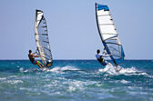 Two windsurfers in action — Stock Photo