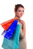 Jolie jeune femme à porter les sacs — Photo